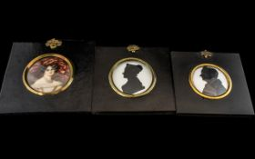 Pair of Early Victorian Silhouettes of a Lady and Gentleman in ebonised frames,