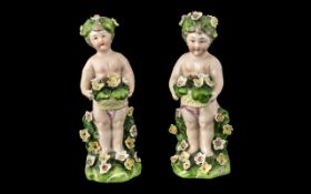 Pair of Antique Dresden Type Figures of Small Garlanded Cherubs. Height 5 Inches. A/F.