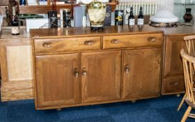 Ercol Dresser comprising two frieze drawers above three cupboard spaces; 31 inches (app.77.