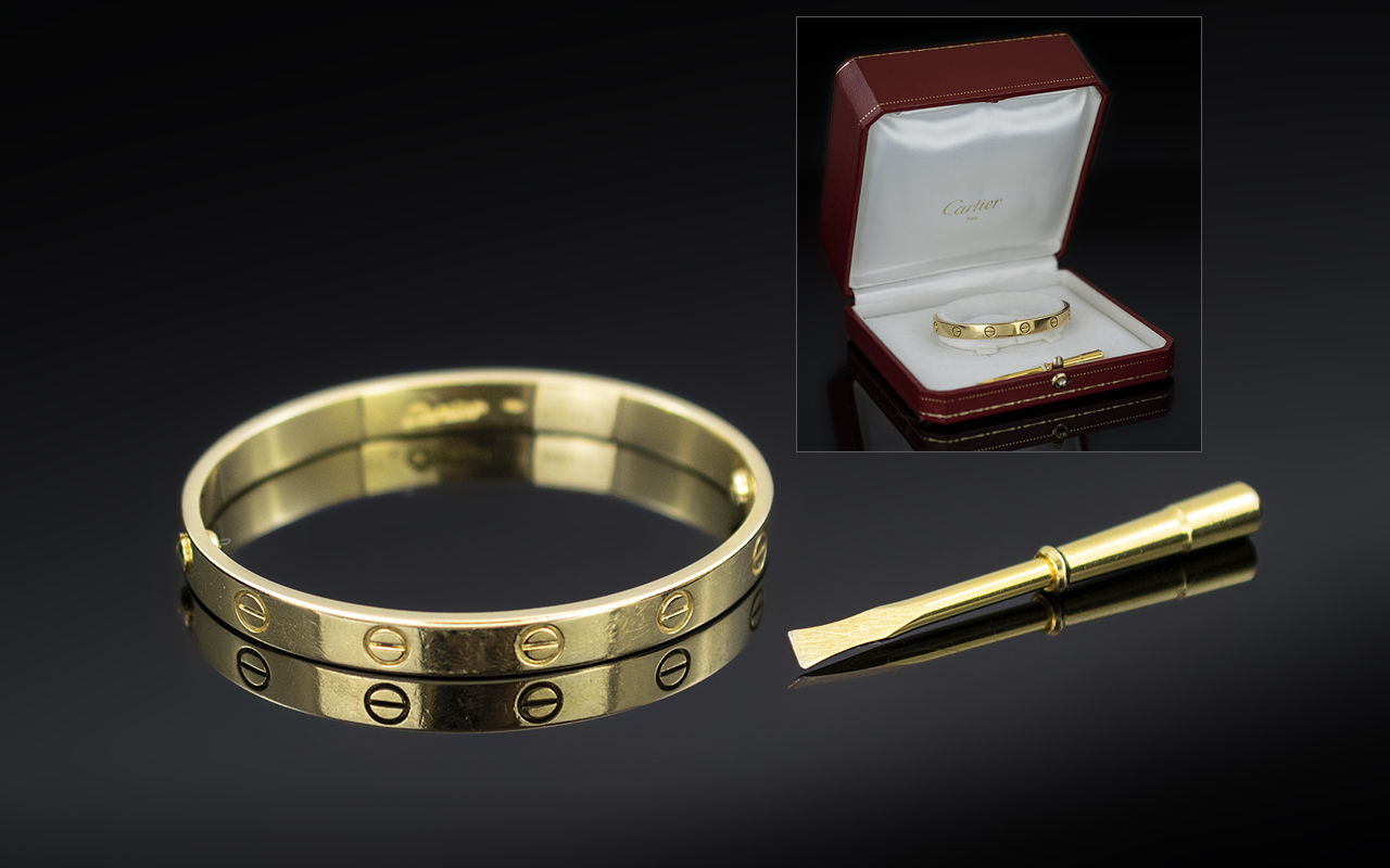 Cartier 18ct Yellow Gold 'Love' Bangle, Decorated with screwhead motifs, signed Cartier and numbered