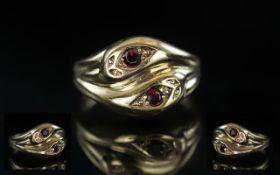 9ct Gold Double Snake Head Ring, Set with Blue Sapphire Eyes. Fully Hallmarked for 9ct. Ring Size S.