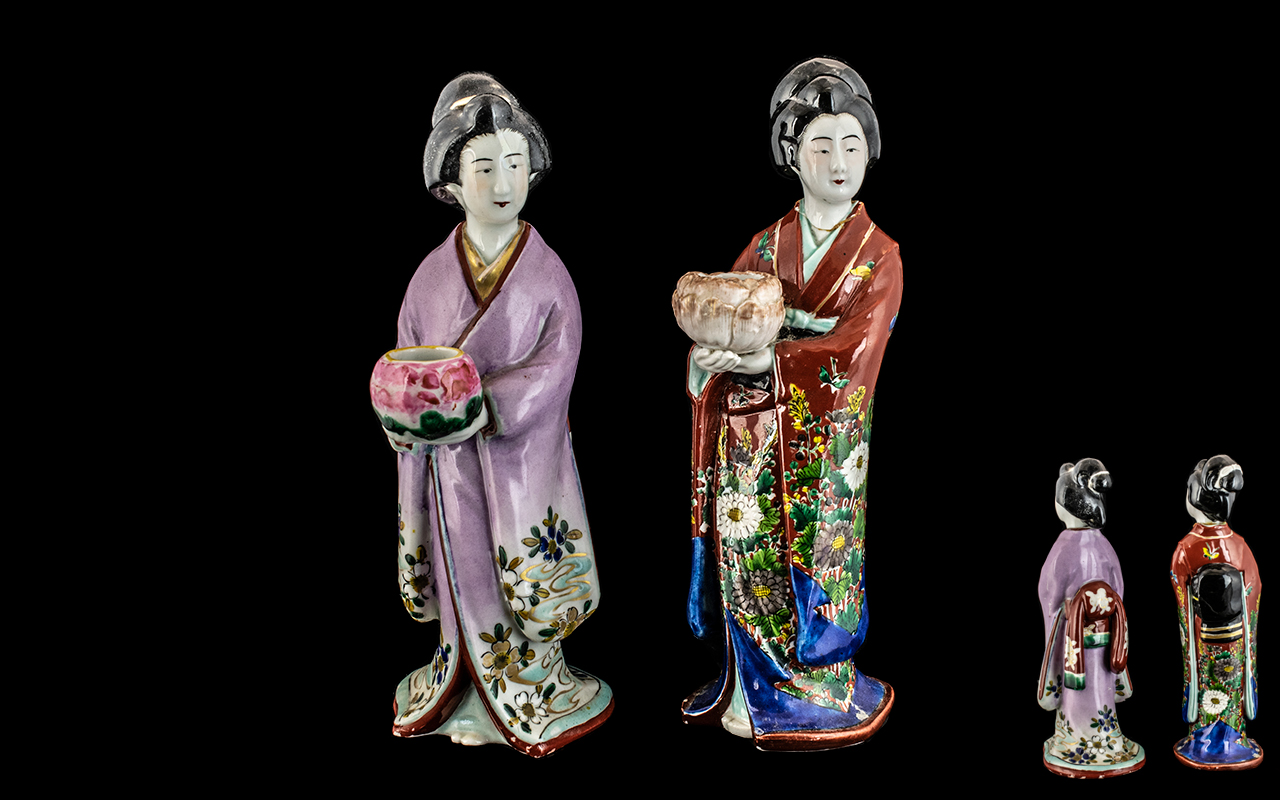 Pair of Japanese Figures Circa 1900, used as candlesticks, a/f.