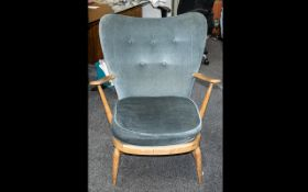 Ercol Windor Armchair, With a Padded Back and Seat and Open Arms of Traditional Shape.