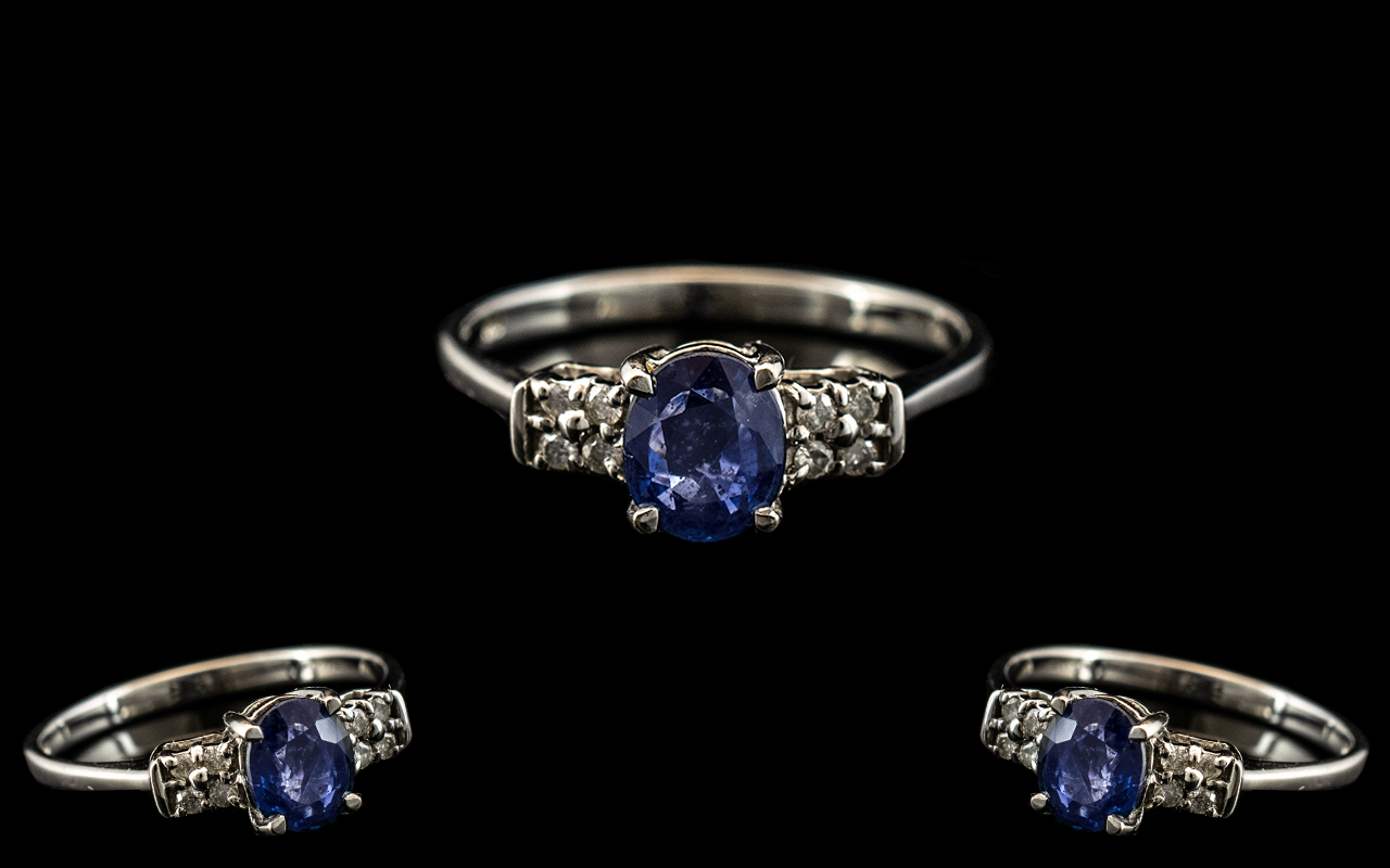 Ladies 9ct White Gold Attractive and Petite Diamond and Sapphire Set Ring, The Sapphire Flanked to