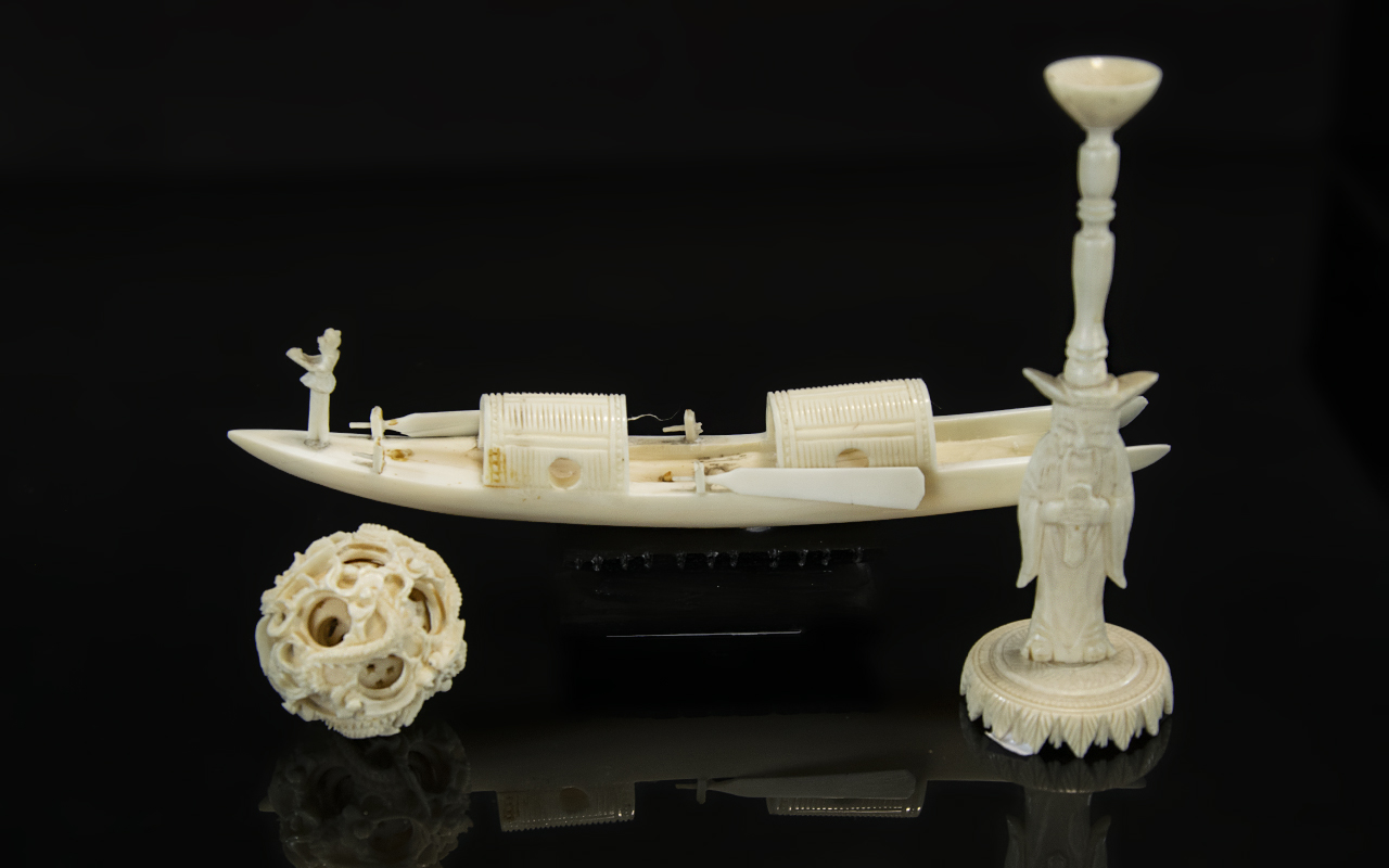 An Antique Chinese Carved Ivory Concentric Ball on Stand, overall height 7''. With a Chinese ivory