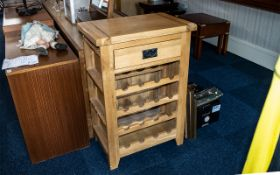 A Contemporary Golden Oak Kitchen Wine Rack/Cutting Block, with a single drawer and wine rack below.