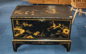 A Chinoiserie Decorated Pine Black Lacquered Bedding Box, with a candle box interior,