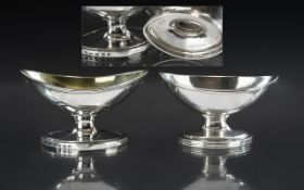 George III - Matched Pair of Large Sterling Silver Boat Shaped Salts. Hallmark London 1794 & 1829.