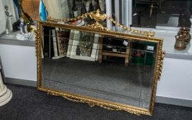 Decorative Over Mantel Mirror, bevelled glass with ornate gilt frame with finial and swags.