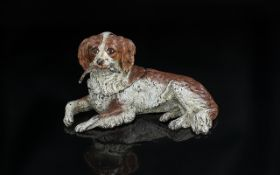 Small Cold Painted Bronze of s Dog holding a pheasant feather in it's mouth;