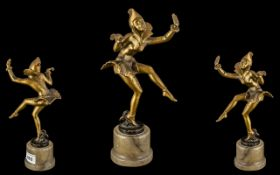 A Cold Painted White Metal Art Deco Period Figure of a Dancing Girl, in the style of Lorenzo, on