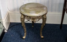 """A Small Circular Onyx Table on brass frame, height 17"""" x 14"""" diameter."""
