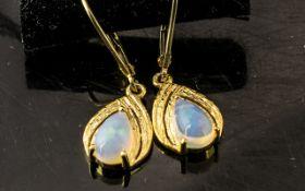 Pair of Opal Drop Earrings, pear cut sol