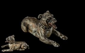 Antique Cold Painted White Metal Figure of a Reclining Dog, on a hinged lid, which opens to reveal