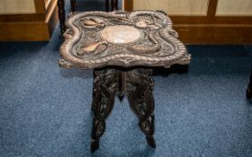 19th Century Chinese Table, highly decorated with dragons and other mythical creatures,