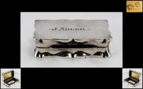 A Silver Snuff Box of shaped rectangular form hallmarked for Birmingham V 1945 2.5 by 1.5 inches.