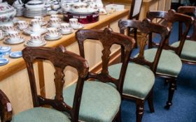 A Set of Six Solid Walnut Riley Bolt Back Patent Chairs each with a carved central splat,