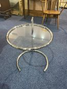 """A Retro Chrome Coffee/Side Table, with a round glass top. Height 24"""" x 19"""" diameter."""