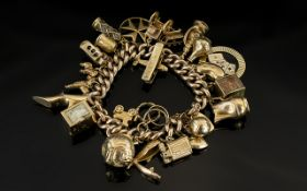 A Vintage 9ct Gold Curb Bracelet Loaded with 25 Superior Quality 9ct Gold Charms. Some Expensive