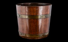 Arts and Crafts R Alister & Co Planter, a late 19th/ early 20thC brass bound planter,
