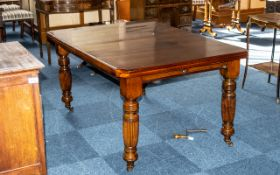 Edwardian Walnut Drawer-Leaf Dining Table, with a wind-out mechanism with two leaves, supported on