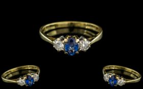 18ct Gold - Attractive 3 Stone Sapphire and Diamond Set Dress Ring.