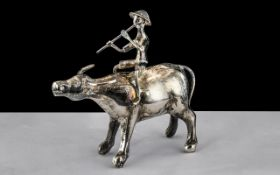 A Fine Chinese Ching Dynasty Antique Silver Model of a Water Buffalo with A Man Riding on Its