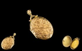 15ct Gold - Attractive Oval Shaped Hinged Locket with Chased Decoration to Front Cover. Marked 15ct.