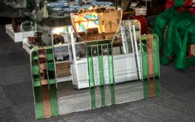 A 1950s Art Deco Style Sectional Wall Mirror in clear, peach and green segments.