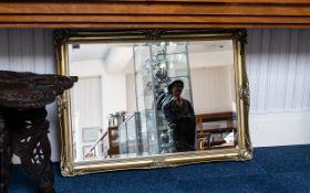 Large Rectangular Gilt Framed Bevelled Glass Mirror, swept moulded frame. Measures 29'' x 40''.
