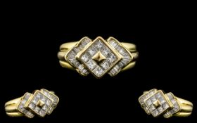18ct Yellow Gold - Attractive Princess Cut and Baguette Cut Diamond Set Ring of Excellent