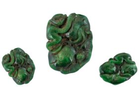 A Dark Green Jade Carving depicting a stylised monkey and Salamander. Measures 2 by 1.5 inches.