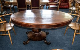 A Large George III Mahogany Tilt Top Loo Table, raised on a pedestal. Lacking connecting bolts.