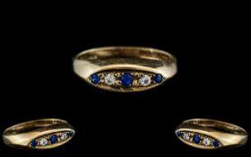 Ladies - Attractive 9ct Gold 5 Stone Diamond and Sapphire Set Dress Ring. Full Hallmark for 9.375.
