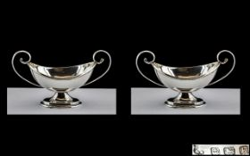 Edwardian Period Pair of Twin Handle Sterling Silver Salts of Trophy Form and Small Proportions.