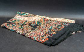 """Large Paisley Shawl in shades of red, cream and black, with fringing. Measures 40"""" x 80"""" approx."""