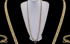 Antique Period - Attractive 9ct Gold Muff Chain of Wonderful Quality and Length. Marked 9ct, c.