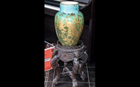 An Anglo Indian Carved Wooden Jardiniere, with carved elephant heads and foliage throughout.