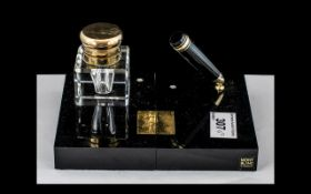 Mont Blanc Desk Set, comprising a crystal glass ink pot with a brass lid engraved Mont Blanc,