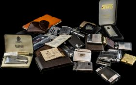 A Collection of Cigarette Lighters, approximately 30, makes to include Ronson, Win, Streamline,