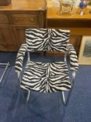A Pel Chrome Cantilever Baushause Style Armchair. Covered in zebra print fabric.