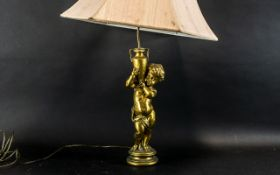 A Gold Cherub Style Table Lamp with Shad