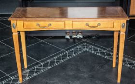 A Yew Wood Console Table with tapering l
