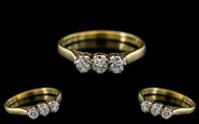 18ct Gold Attractive 3 Stone Diamond Set Ring. The Round Brilliant Cut Diamonds of Good Sparkle.