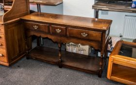 Oak Dresser of small size, in the Georgian style, made by Titchmarsh & Goodwin of Ipswich,