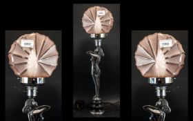An Art Deco Period Chrome Lamp in the shape of a lady,