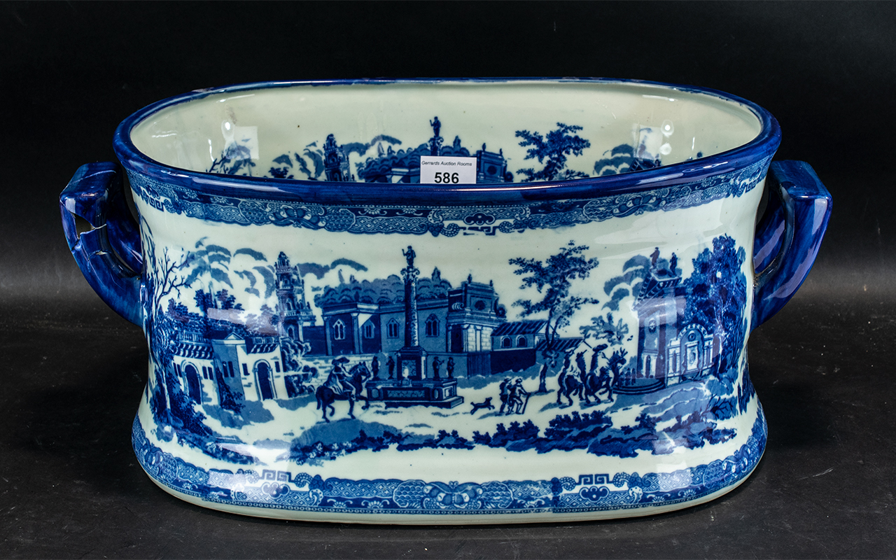 Large Blue & White Pottery Foot Bath, with a Victoria ware mark to base, a/f. Measures 18'' wide x