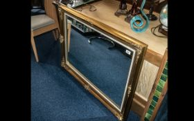 Large Reproduction Gilt Swept Frame Mirror, With Material Inner Slip. Size 30 x 43 Inches.