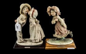 Two G Armani Capodimonte Italian Figures, one depicting two children kissing entitled 'Shy Kiss',