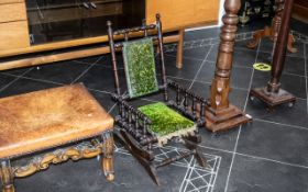 A Small Child's Turned Bobbin Rocking Chair, on a platform base, with springs, stained beech,